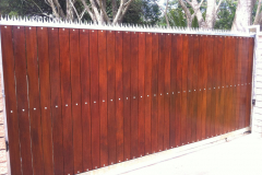 Spiked-wooden-sliding-gate-installation-6