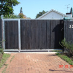 Creosote Slated Sliding Gate With Pedestrian Gate And Steel Frame