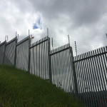 Electric Fence Installation On Palisade Fencing