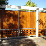 Meranti Wooden Sliding Gate With Customised Design And A Swing Pedestrian Gate