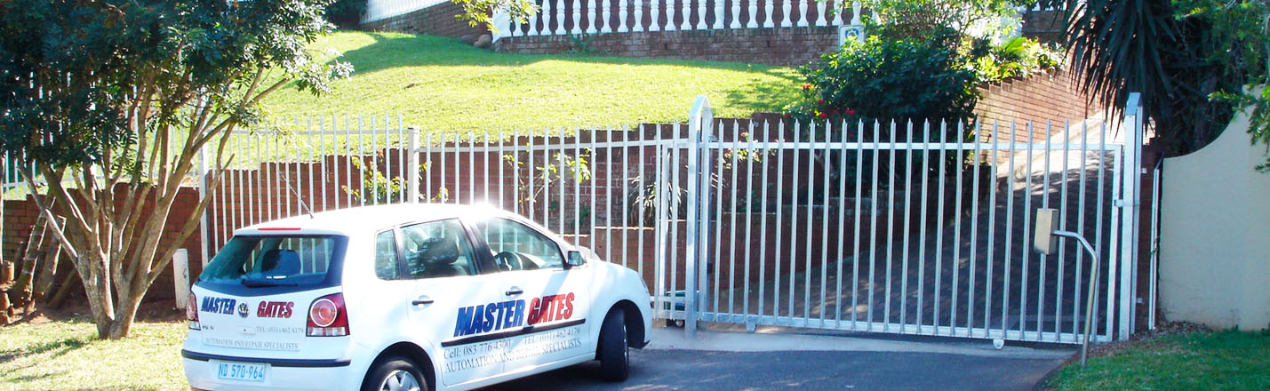Master Gates Car In Front Of Electric Gate