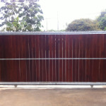 Spiked Wooden Sliding Gate And Motor Installation