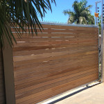 Spiked Wooden Sliding Gate With Horizontal Slats