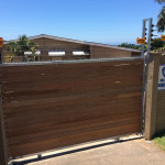 Vertical Slated Wooden Sliding Gate With Electric Fencing