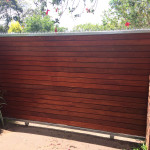 Wooden Sliding Gate With Steel Spikes And Horizontal Slats