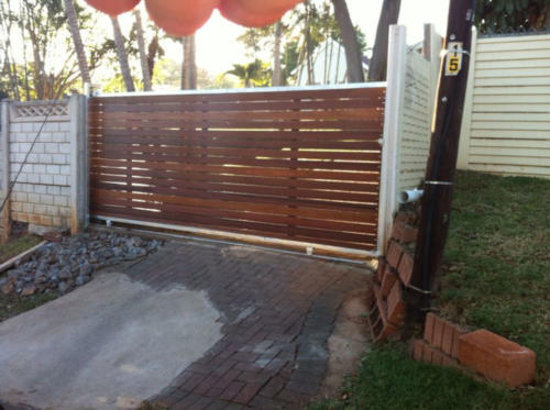 Wooden Sliding Gate With Horizontal Slats And A Steel Frame