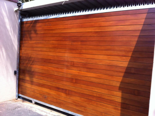 Wooden Sliding Gate With Horizontal Slats And Steel Spikes