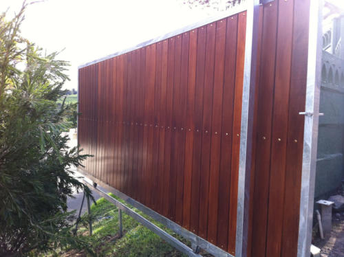 Balau Wooden Sliding Gate With Vertical Slats And Steel Spikes