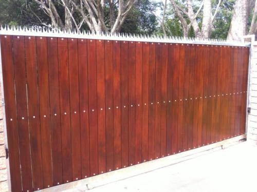 Spiked Wooden Sliding Gate Installation