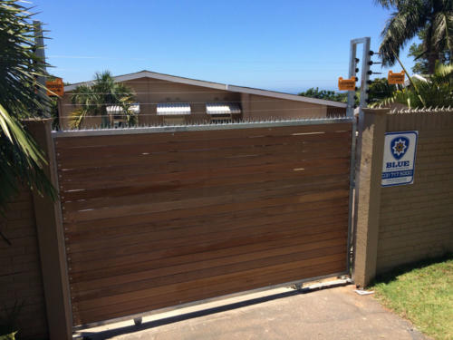 Horizontal Slated Wooden Sliding Gate With Electric Fencing