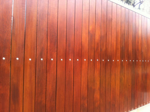 Vertically Slated Wooden Sliding Gate Installation