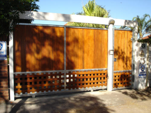 Wooden Sliding Gate With Steel Frame And Pedestrian Swing Gate