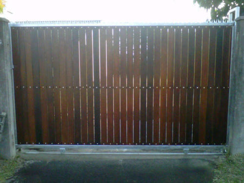 Wooden Sliding Gate With Vertical Slats And A Steel Frame